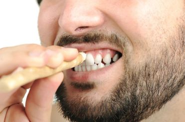 man-cleaning-teeth-miswak-stick-jpg-653x0_q80_crop-smart